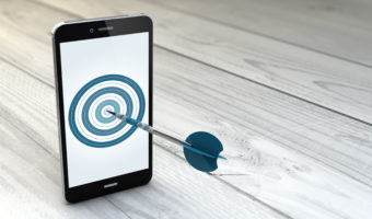 45968879 - digital generated mobile marketing and targeting. smartphone with dartboard in the screen.